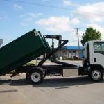 Truck lifting dumpster bin