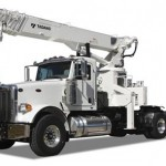 Extended boom crane on small truck